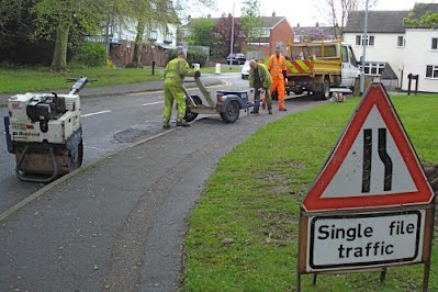 Repair crew fixing pothole